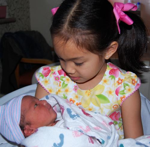 Miranda holding her baby brother, Paulo