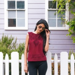 Pair this maroon crop top with a oversized cardigan, high waisted jeans, and tall boots for a Fall ready look!