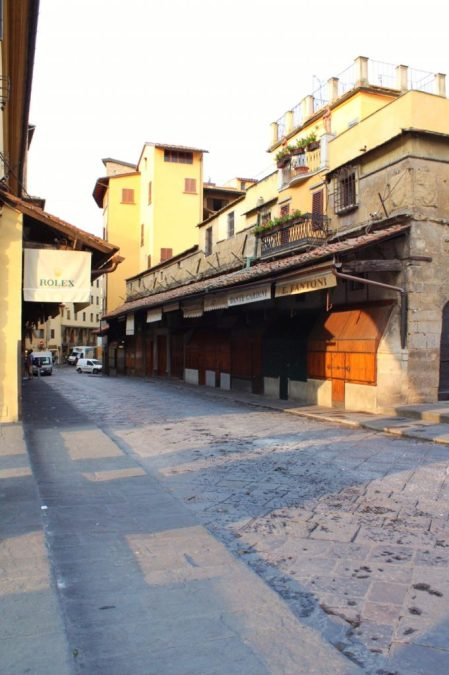 Walking down the Ponte Vecchio early in the morning