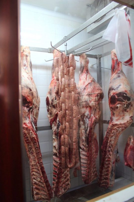 Meat hanging in the butcher shop in Chianti