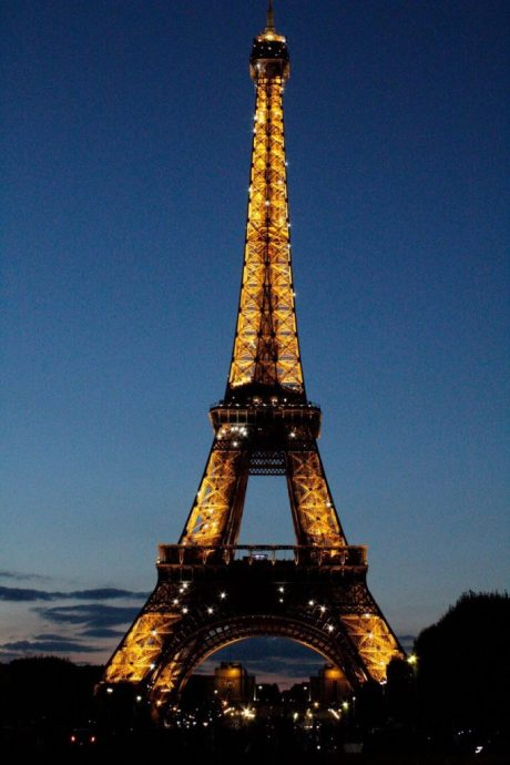 The Eiffel Tower at night in Paris France