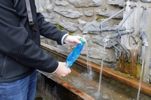 Filling a water bottle outside in Switzerland