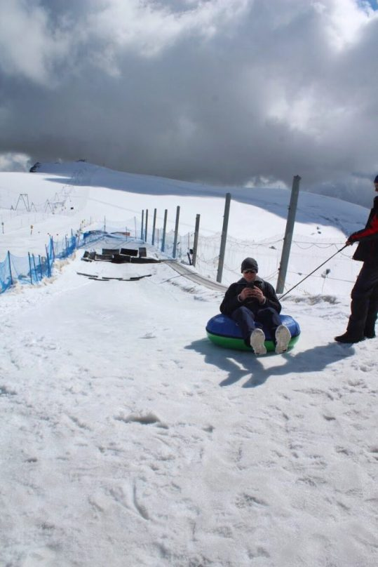 Eric snow tubing at the Matterhorn Glacier Paradise in Zermatt Switzerland
