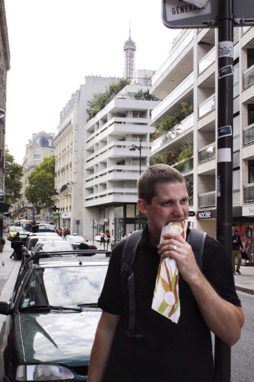 Eric eating a sandwich in Paris France