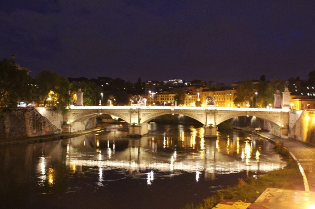 bridge across the Arno river in Rome Italy at night