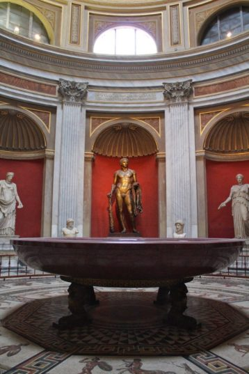 Bronze statue of Hercules at the Vatican Museum in Rome Italy
