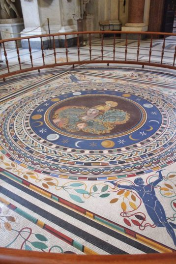 Tiled floor at the Vatican Museum in Rome Italy