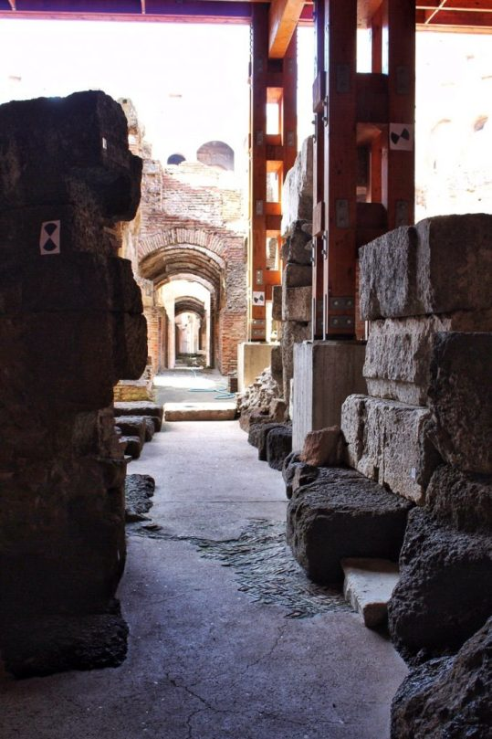 Exploring underground at the Colosseum in Rome, Italy