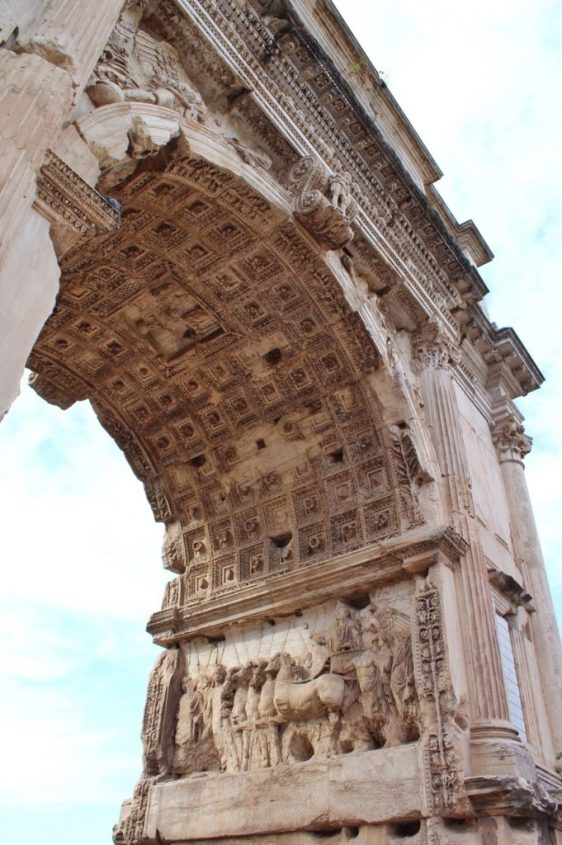 The Arch of Titus inside the Roman Forum in Rome Italy