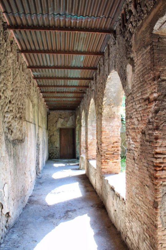Hallway Inside the ruined city of Pompeii Italy