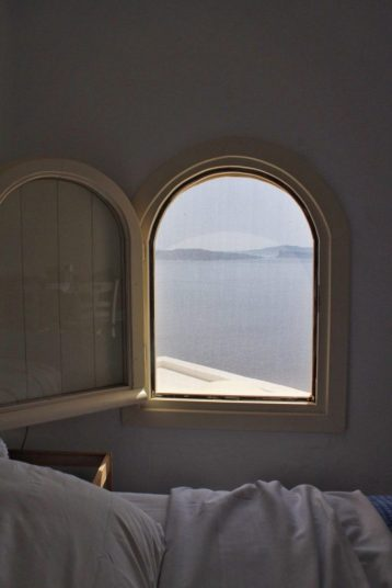 Small window next to our bed in our Airbnb in Santorini