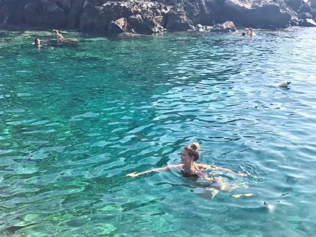Lauryn swimming at Amoudi Bay in Santorini