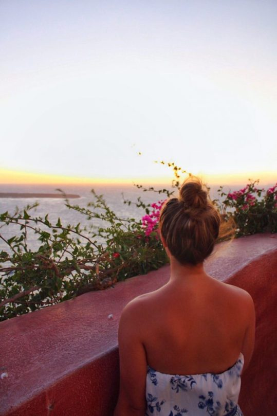 Lauryn looking at the sunset in Oia, Santorini