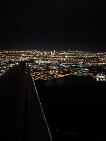 View of New York City at night from the plane