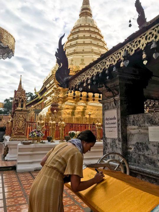 Signing the orange tapestry at Wat Phra That Doi Suthep Chiang Mai