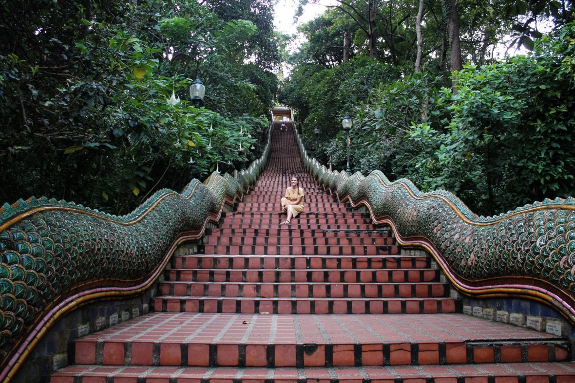 Sitting at entrance of Naga Staircase Wat Phra That Doi Suthep Chiang Mai