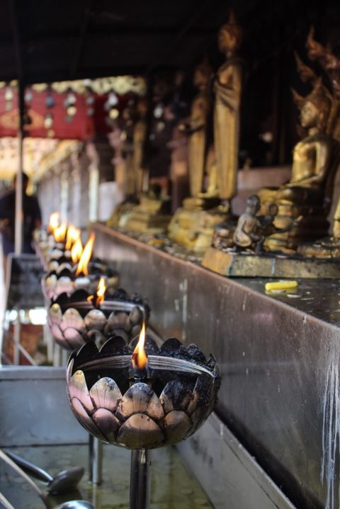 Torches lit at Wat Phra That Doi Suthep Chiang Mai