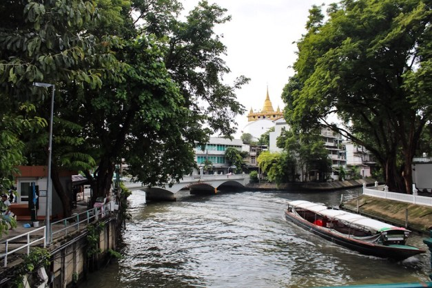A boat traveling down the river in Bangkok, Thailand