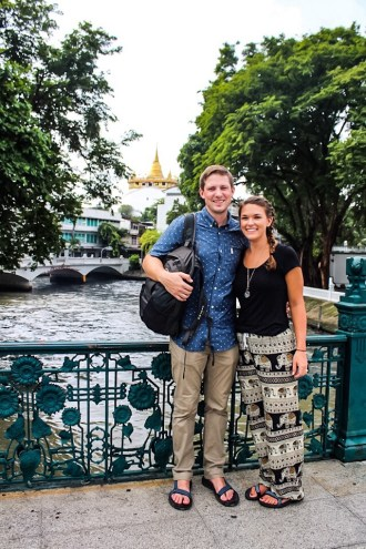 Lauryn and Eric standing by the river in Bangkok, Thailand