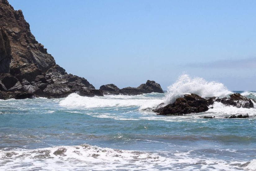 Waves crashing against rocks at Pfeiffer Beach in California