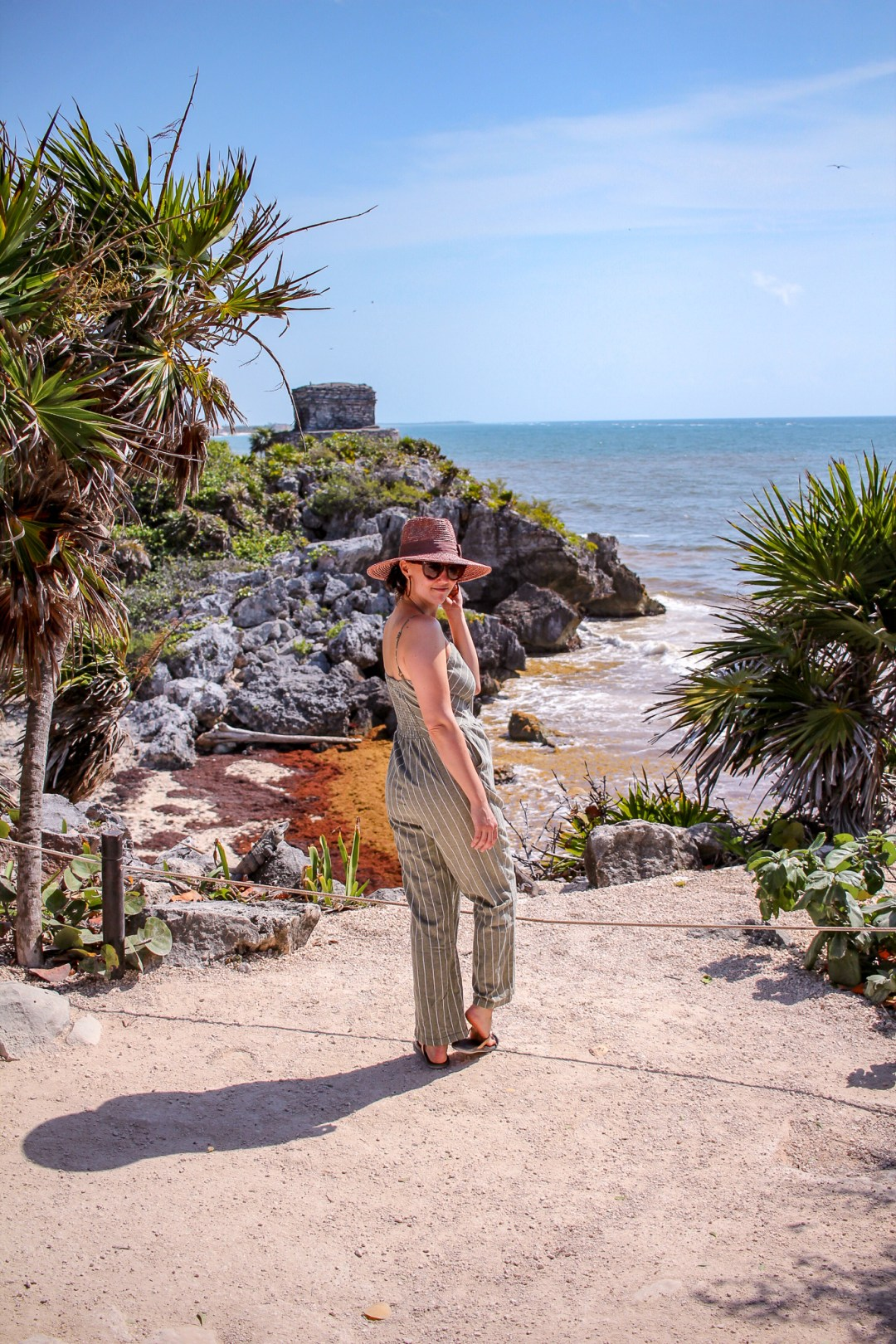 girl in front of tulum ruins