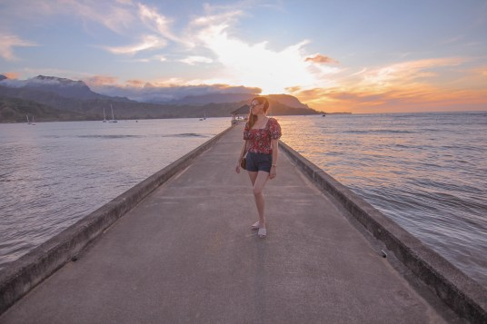 girl on hanalei pier in kauai