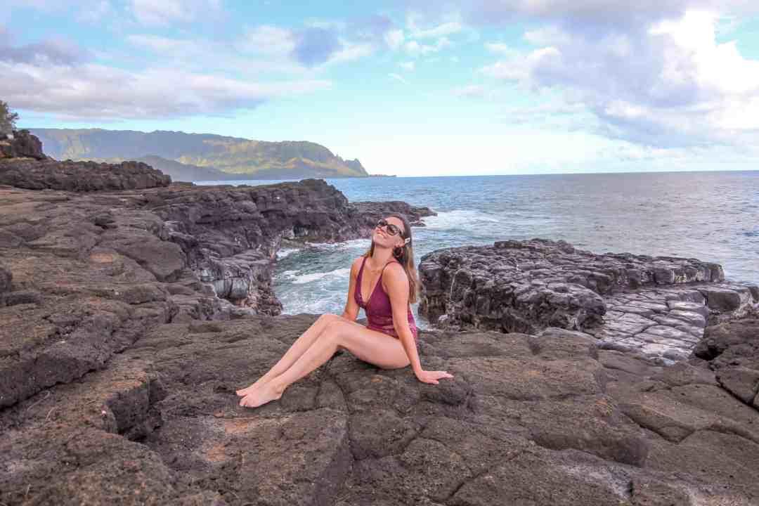 girl in queens bath kauai hawaii