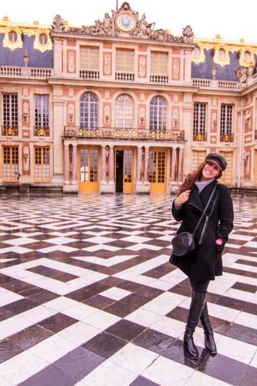 girl in front of palace of versailles
