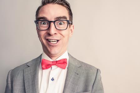 Silly businessman in red bow tie
