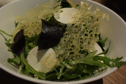 Arugula salad with truffles, mushrooms, parmesan, and a soy dressing. Served together with the truffle bread.