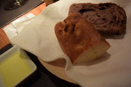 Bread served with the fish- red-wine grape bread and focaccia with Spanish olive oil and salt.
