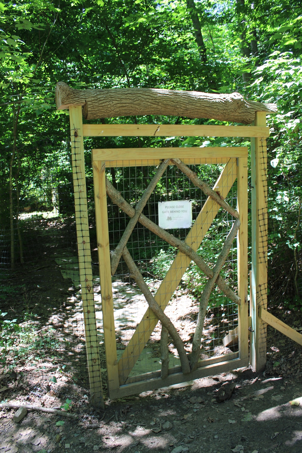 a wood and chicken wire gate