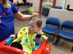 My hair was out of control, so we went to the salon, the one with the car chair and the elmo dvd.