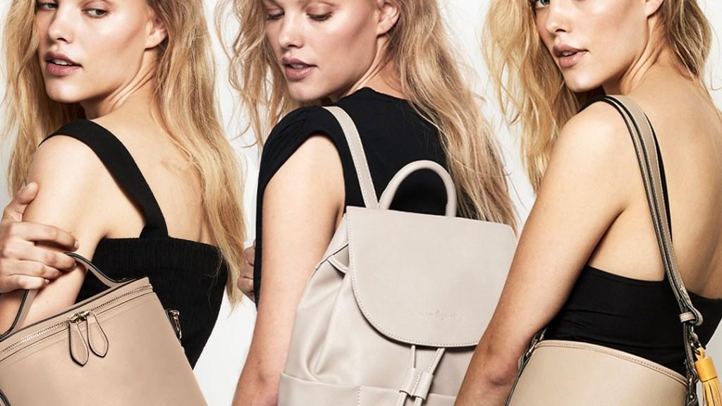 three women showcasing the Urban Originals vegan bags.