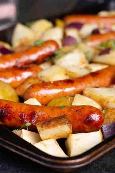 This oven-roasted sausage and potatoes bake is easy, simple, and delicious. Perfect for a school-night family dinner. Chicken sausage and apples give this classic a delicious fall spin. This one sheet-pan supper just happens to be gluten-free, dairy-free and paleo-friendly too. #dinner #recipe #onepotmeal *My kids love this recipe (minus the suggested dollop of mustard!!!!)