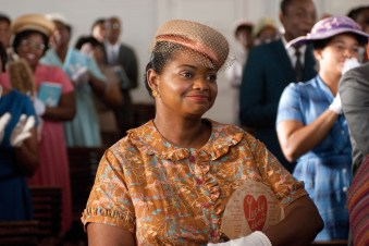 """""""THE HELP"""" TH-285 Minny Jackson (Octavia Spencer) looks on as her friend Aibileen is applauded for her courage by their fellow churchgoers, in DreamWorks PicturesÕ inspiring drama, ÒThe Help,Ó based on the New York Times best-selling novel by Kathryn Stockett. ÒThe HelpÓ is written for the screen and directed by Tate Taylor, with Brunson Green, Chris Columbus and Michael Barnathan producing. Ph: Dale Robinette ©DreamWorks II Distribution Co., LLC. ÊAll Rights Reserved."""