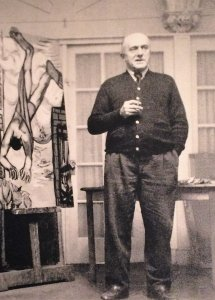 Max Beckmann in his NY studio on East 19th Street, with Hanging Man (1950). Exhibition photo.