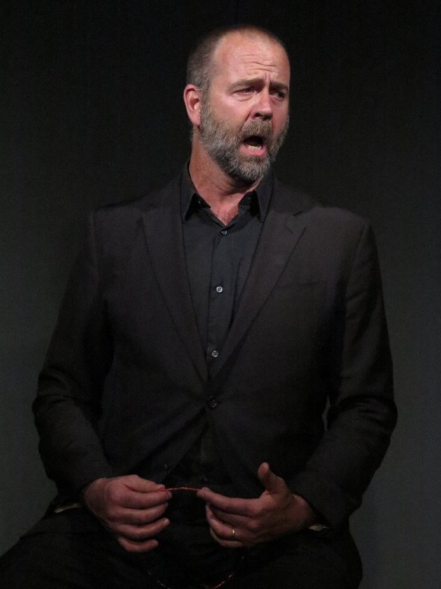 Paul Goodwin Groen as Creon, singing Ella Giammai from Verdi's Don Carlo in Fusion Theatre's Antigone by Jean Anouilh. Photo Jonathan Staff