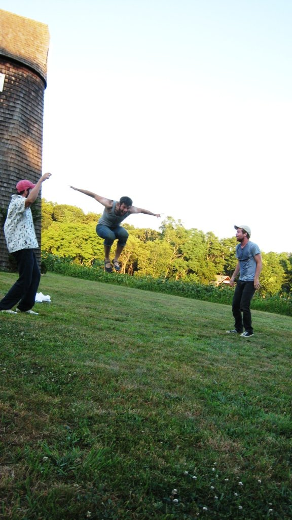 Dave Shaw as a Caliban leaps, over-excited by the new brew -- wine -- that David Gautchy as Stephano (L) and Brendan Boland as Trinculo (R) haveintroduced him to. Photo: Robert Ruben