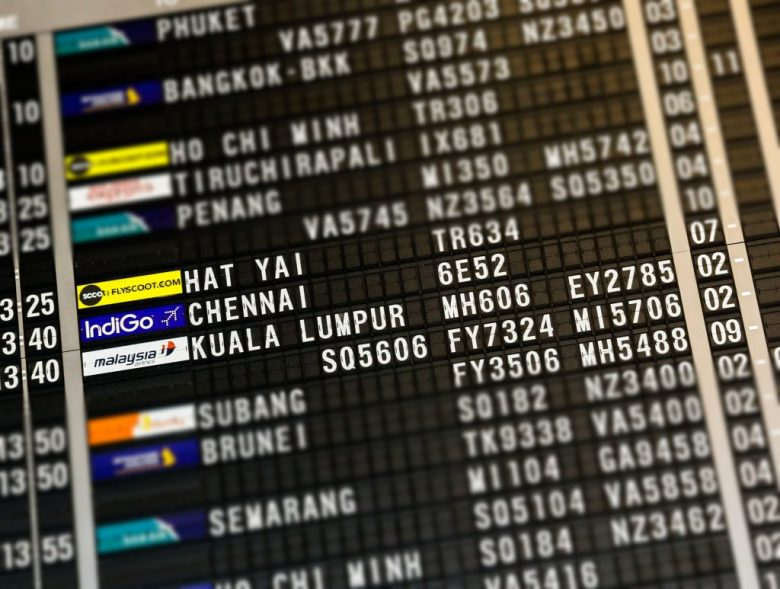 a flight board with different flight numbers on it