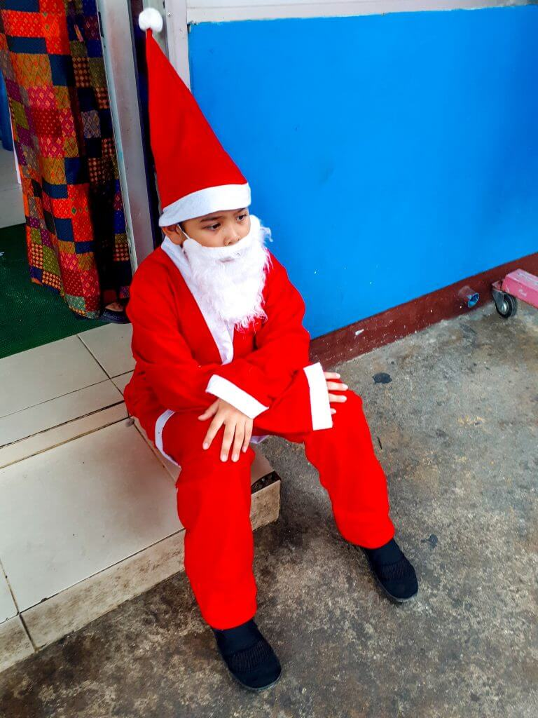Children dressing up in Christmas clothes to celebrate the holiday