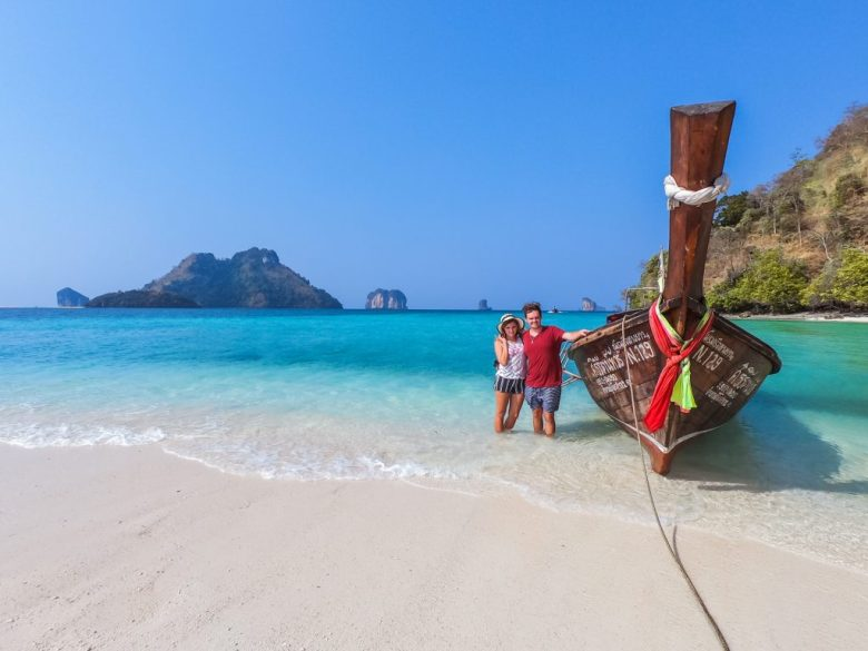 Chane and Jonathan taking a long tail boat to an island in Krabi, Thailand