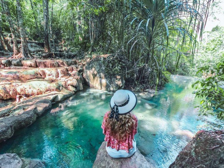 Chane enjoying a beautiful waterfall in Kanchanaburi Thailand