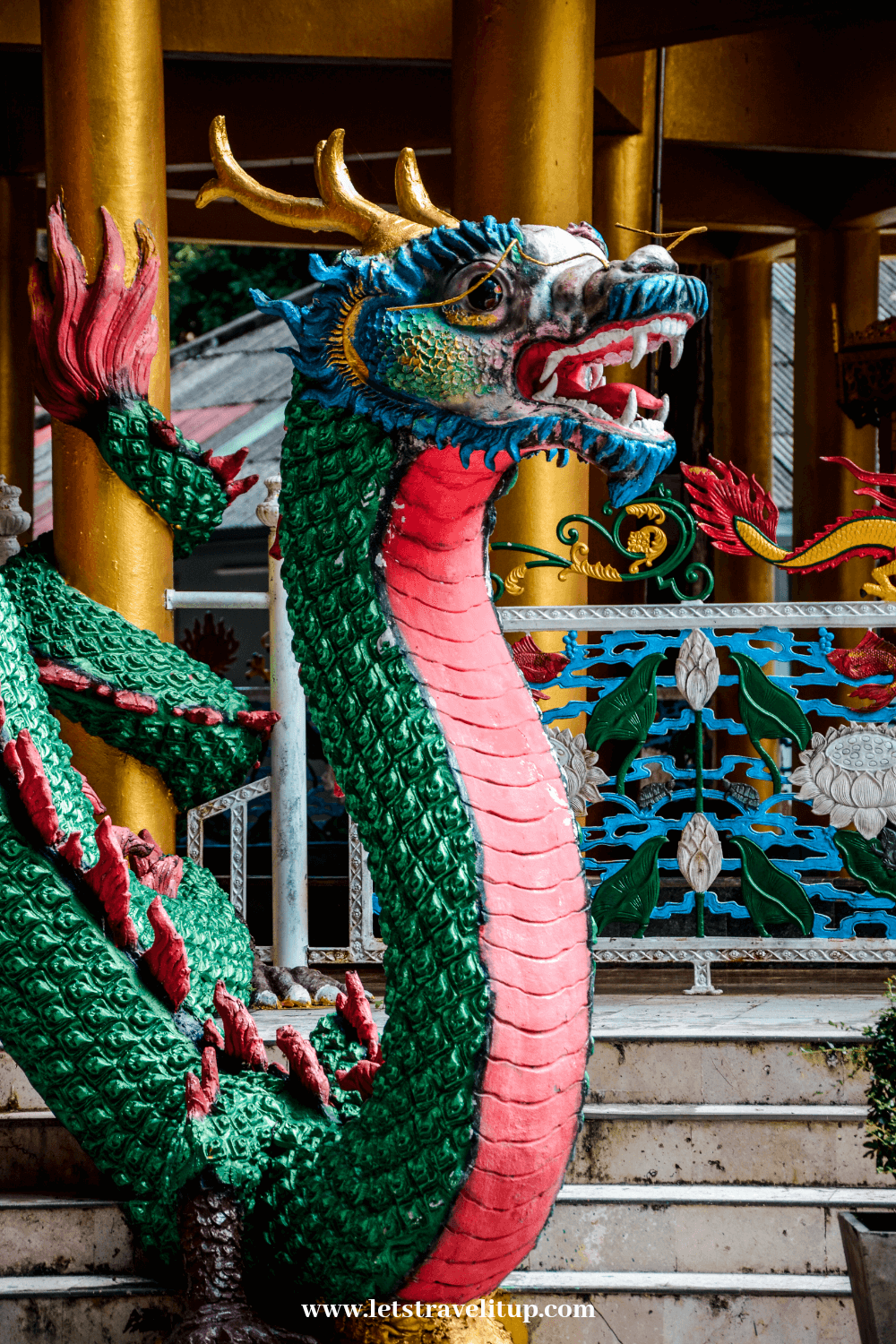 the dragons located at the entrance of temple are there to protect the temple from bad spirits.