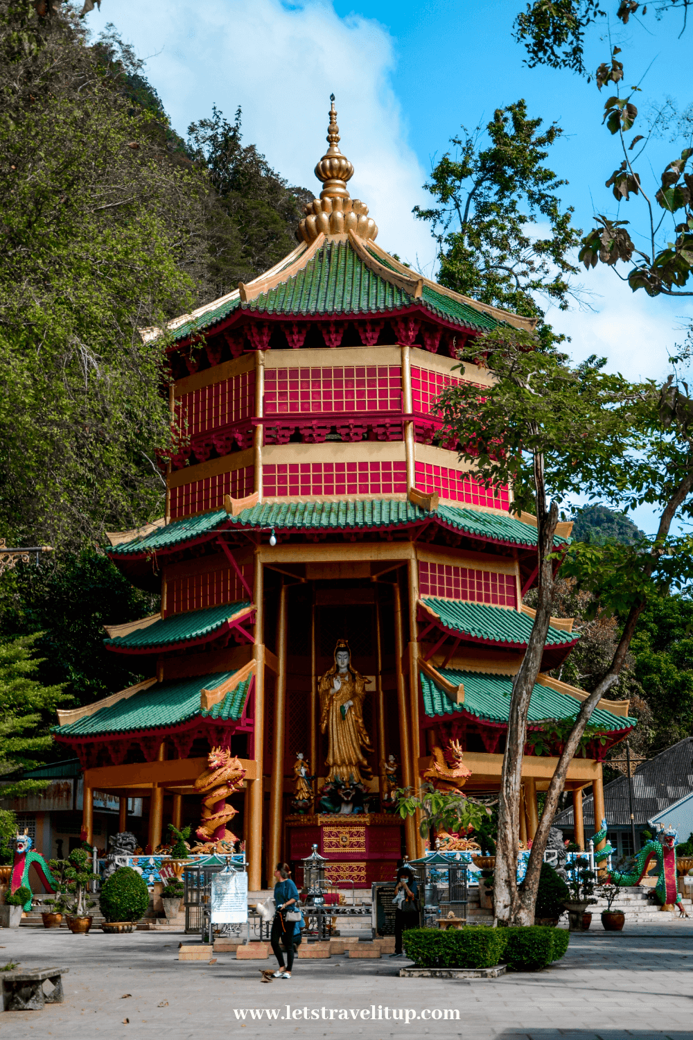 Green and red Chinese tempe that is located at the bottom of the mountain at tiger cave temple