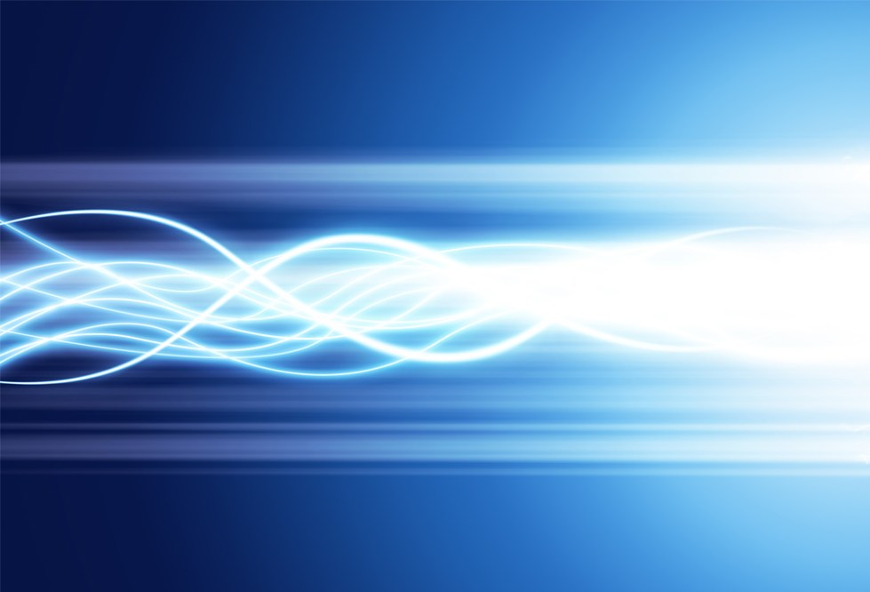 Abstract image of waves of bright light against a blue background