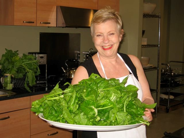 Ann Ogden holds a platter of fresh spinach for patients. Nutritious food is key for patients after a Whipple procedure.