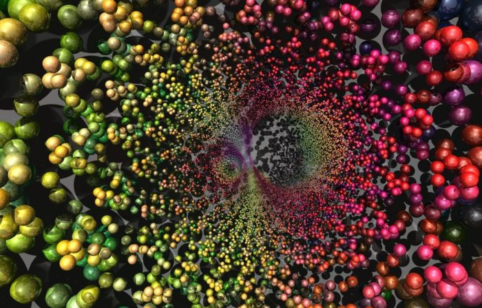 Abstract Image Of DNA Structure, With Linked Balls Of Greens On The Left And Reds And Pinks On The Right, Forming A Spiral Net