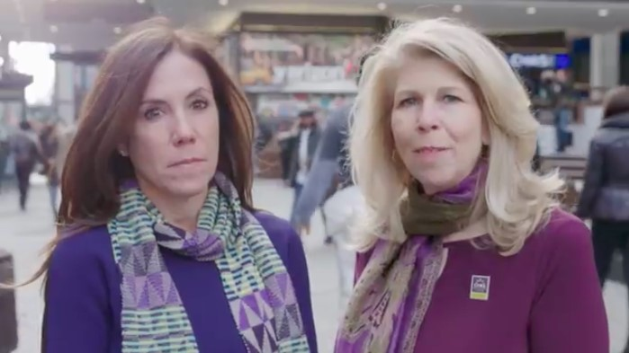 Cindy Gavin (Let's Win) and Kerri Kaplan (Lustgarten Foundation) wearing purple on a New York street for World Pancreatic Cancer Day