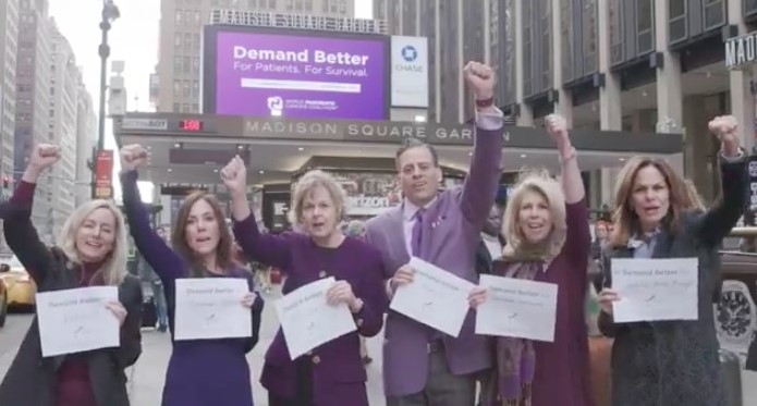 Julie Fleshman (PanCAN), Cindy Gavin (Let's Win), Barbara Kenner (Kenner Family Research Fund), Dino Varelli (Project Purple), Kerri Kaplan (Lustgarten Foundation), Liz Feld (Suzanne Wright Foundation) in front of the Madison Square Garden marquee in New York, for World Pancreatic Cancer Day